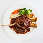 A lamb chop with figs and vegetables