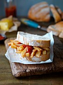 A chip butty with ketchup