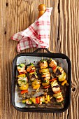 Salmon and potatoes skewers with peppers and courgettes