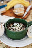 Mushroom soup with melted cheese