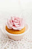A cupcake decorated with a sugar flower