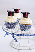 Cupcakes decorated with vanilla cream and mortar boards