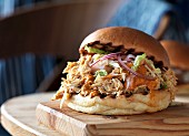 Pulled chicken burger with onions