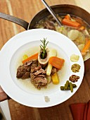 Pot au feu with vegetables and beef