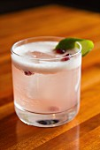 A Gin Fizz with pomegranate seeds