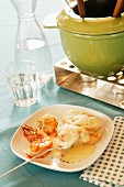 Cheese fondue with prawns and bread