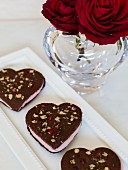 Heart-shaped chocolate biscuits filled with cream for Valentine's Day