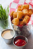 Potato croquettes with tartare sauce and ketchup
