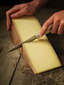 Gruyere being sliced