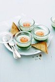 Creamy spinach with egg cooked in jars