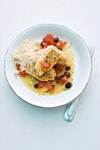 Spring chicken breast cooked in a jar with raisins and tomatoes