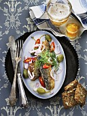 Fried herring with chilli and capers served with Aquavit and beer (Scandinavia)