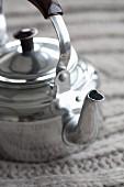 An aluminium teapot