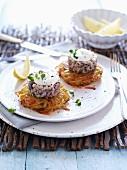 Herring tartar on potato cakes