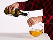 Decanting a bottle of Domaine Pignier Vin Jaune. [Côtes du Jura]