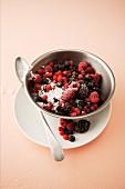 Sugared berries in a metal bowl