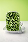 A block of frozen peas with a spoon