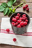 Fresh raspberries in a metal container