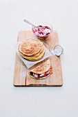 Pancakes filled with red berry jelly and quark