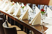 A table laid for a wedding reception in a restaurant