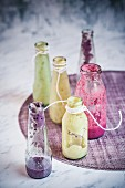 Empty bottles of fruit smoothies (raspberry, blueberry, apple)