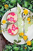 Cupcakes with spring flowers in a garden
