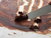Chocolate curls being made using a knife