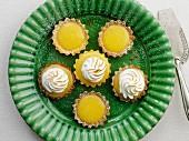 Mini lemon curd and meringue tartlets on a plate