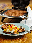 Waffles with fruit compote and cream