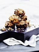 A stack of rhubarb muffins with nuts