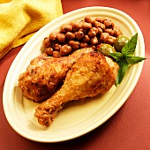 Crispy chicken drumsticks with fava beans and olives (Spain)