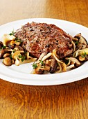 A sirloin steak with a mushroom ragout