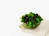 Mixed salad leaves in glass bowl