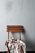 Coffee, tartlets and biscuits on a wooden chair