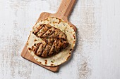 Grilled chicken breast on unleavened bread