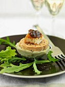 Goose liver on an artichoke heart with toast and chutney