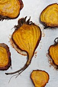 Halved and roasted golden beets with salt and pepper