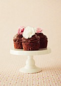 Chocolate and cherry cupcakes on a cake stand