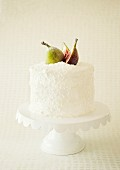 A coconut cake with fresh figs