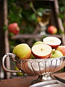 Fresh apples in a silver bowl