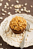 A chocolate cupcake topped with caramelised puffed rice