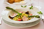 Pork medallions with noodles and asparagus