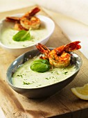 Cold cucumber soup with herb prawns