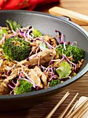 Pork with broccoli and bean sprouts in a wok