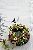 A Christmas wreath made from shimeji mushrooms and viburnum