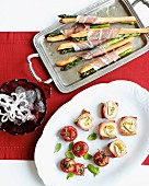 Christmas appetisers: grissini with asparagus and ham, crostini with smoked salmon, ricotta and courgette, stuffed cherry tomatoes