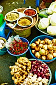 Various types of vegetables and spices at a market in Saigon (Vietnam)