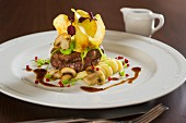 Beef fillet with potato crisps and mushrooms