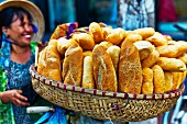 A basket of Vietnamese white bread at a market
