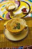 Vietnamese asparagus soup with a pastry lid